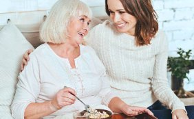 old woman and caregiver smiling