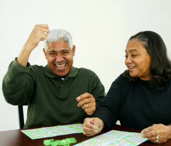 elderly man and caregiver playing